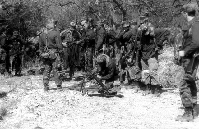 U.S. Marines set up mortars and M-60 machine guns prior to a firing demonstration for South Korean newsmen during exercise Team Spirit '82