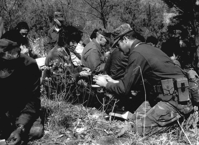 U.S. Marines show a group of South Korean newsmen how to prepare survival rations during exercise Team Spirit '82
