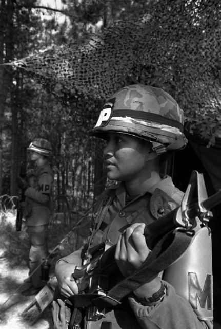PFC Moana N. Magalei, a member of the 25th Infantry Division Military Police Company, guards the 25th Infantry Division Headquarters during the joint Republic of Korea/U.S. training exercise Team Spirit '82