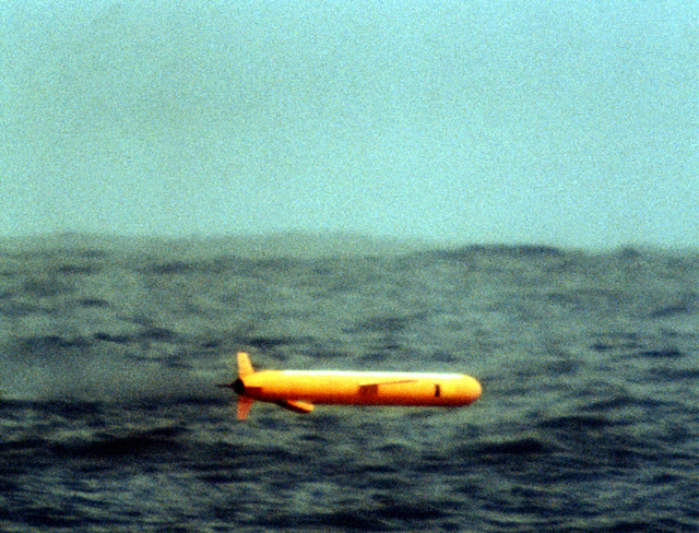A view of a BGM-109 Tomahawk missile, before entering the water, during a land attack conventional missile operation test near the Pacific Missile Test Center, Point Mugu, California