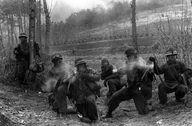 An M-60 machine gun crew of the Combat Support Co., 1ST Bn., 21st Inf., 25th Infantry Div., fires toward Orange Forces in a counterattack to restore the forward edge of a battle area during the height of the joint South Korea/U.S. training exercise Team Spirit '82