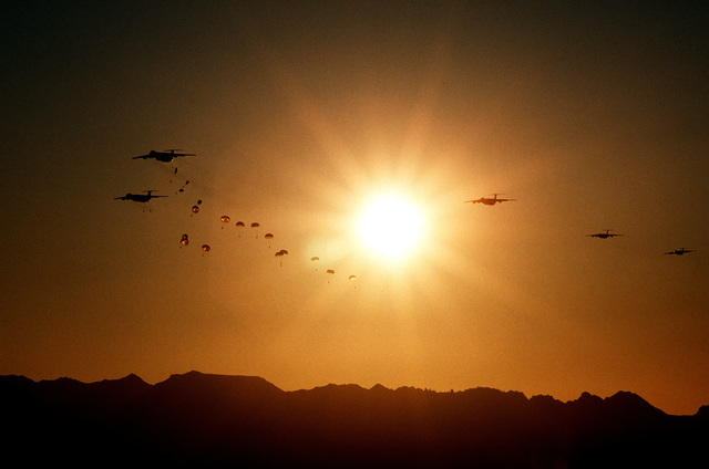 Members of the 82nd Airborne Division parachute from C-141 Starlifter aircraft over Landing Zone Nelson during exercise Gallant Eagle
