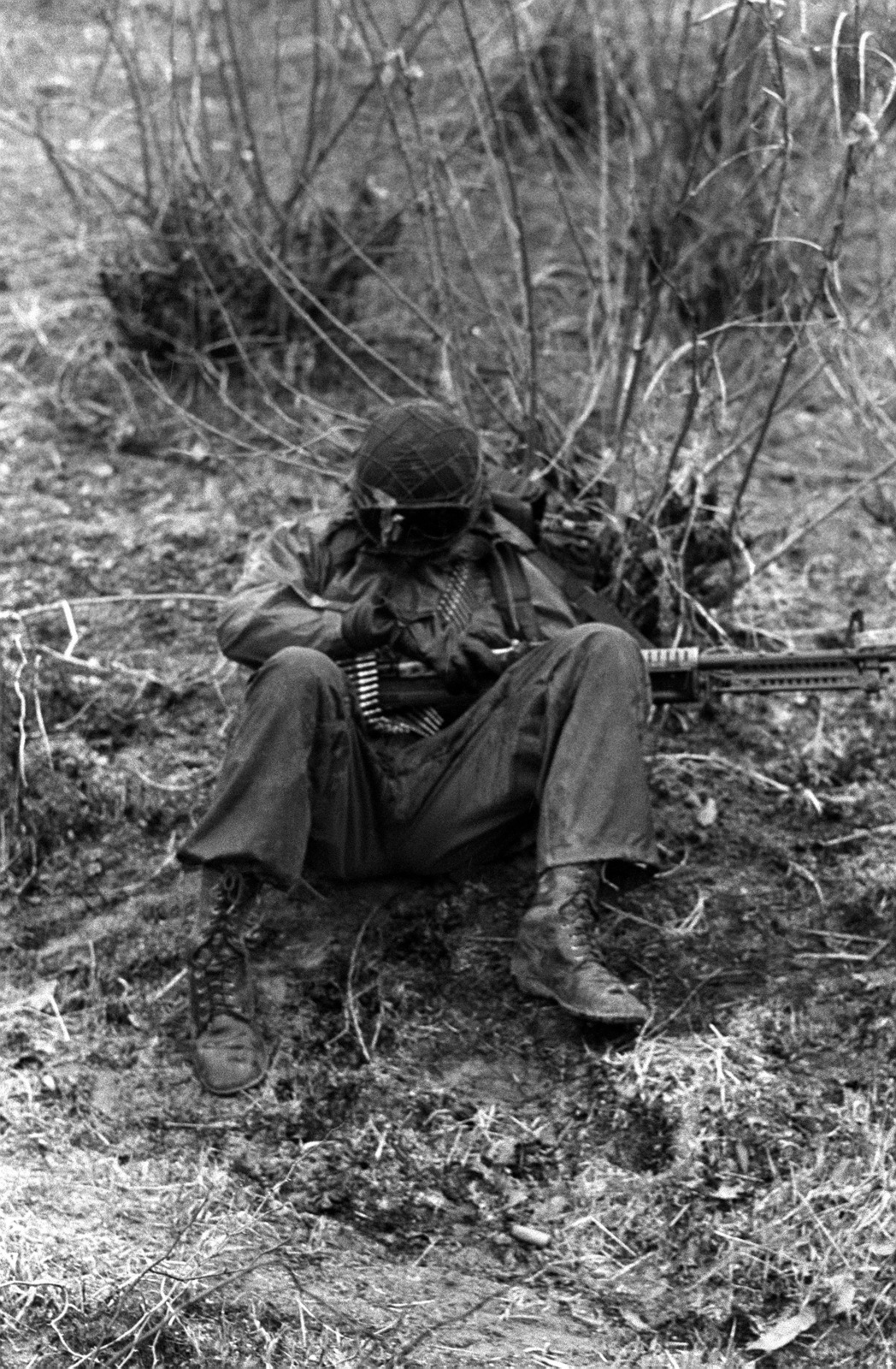 PVT Paul Perkins of the Combat Support Co., 1ST Bn., 21st Inf., 25th Infantry Div., takes a nap while awaiting the word to move forward in a counterattack against the Orange Forces during the height of the joint South Korea/U.S. training exercise Team Spirit '82