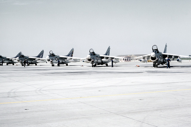 A-7 Corsair II aircraft from Carrier Air Wing 14 (CVW-14) lined up on the air field arriving from a Western Pacific deployment aboard the aircraft carrier USS CORAL SEA (CV-43)