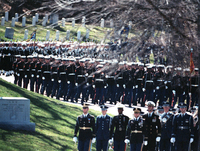A joint services honor guard participates in the full honors funerals for GEN Nathan Twining, chairman of the Joint Chiefs of STAFF from 1957-1960, at the Arlington National Cemetery