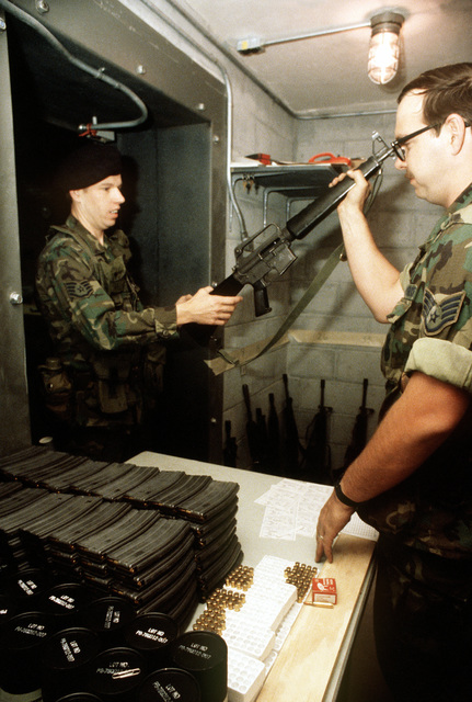 A member of the 91st Security Police Squadron is issued an M-16A1 rifle prior to participating in Air Base Ground Defense operations as part of Exercise Gallant Eagle '82