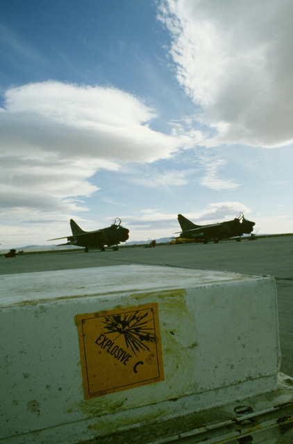 A right front view of two Air National Guard A-7D Corsair II aircraft on the flight line during Exercise Gallant Eagle '82