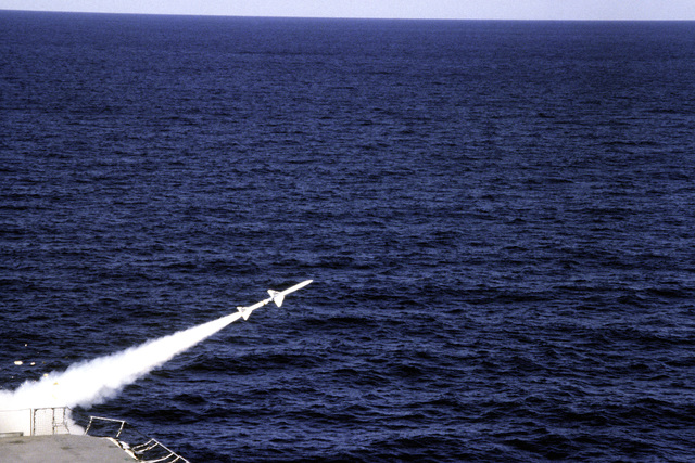 A view of a RIM-7 Sea Sparrow missile being launched from the amphibious assault ship USS NASSAU (LHA-4)