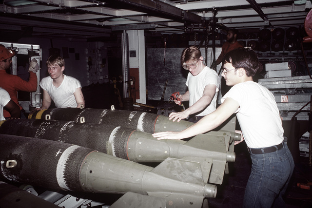 A view of the bomb preparation table with Mark 82 bombs on it in the bomb assembly room aboard the aircraft carrier USS JOHN F. KENNEDY (CV-67)