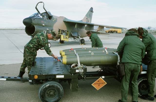A weapons technician places a fuse into the nose of a 500-pound bomb before it is uploaded onto an A-7D Corsair II aircraft during Exercise Gallant Eagle '82