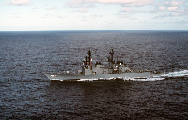 Aerial port bow view of the destroyer USS KINKAID (DD 965) underway off the coast of California