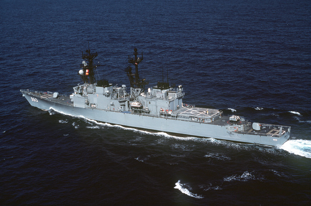 Aerial port quarter view of the destroyer USS KINKAID (DD 965) underway off the coast of California