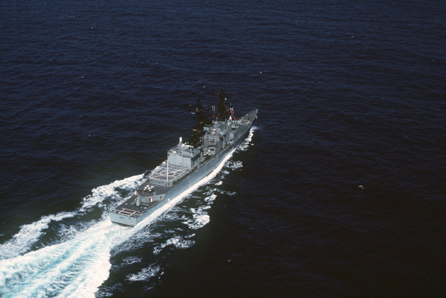 Aerial starboard quarter view of the destroyer USS KINKAID (DD 965) underway off the coast of California