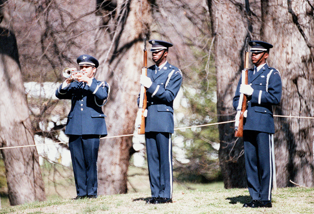 An Air Force bugler blows taps at the conclusion of the funeral service for GEN Nathan Twining, chairman of the Joint Chiefs of STAFF from 1957-1960, at Arlington National Cemetery