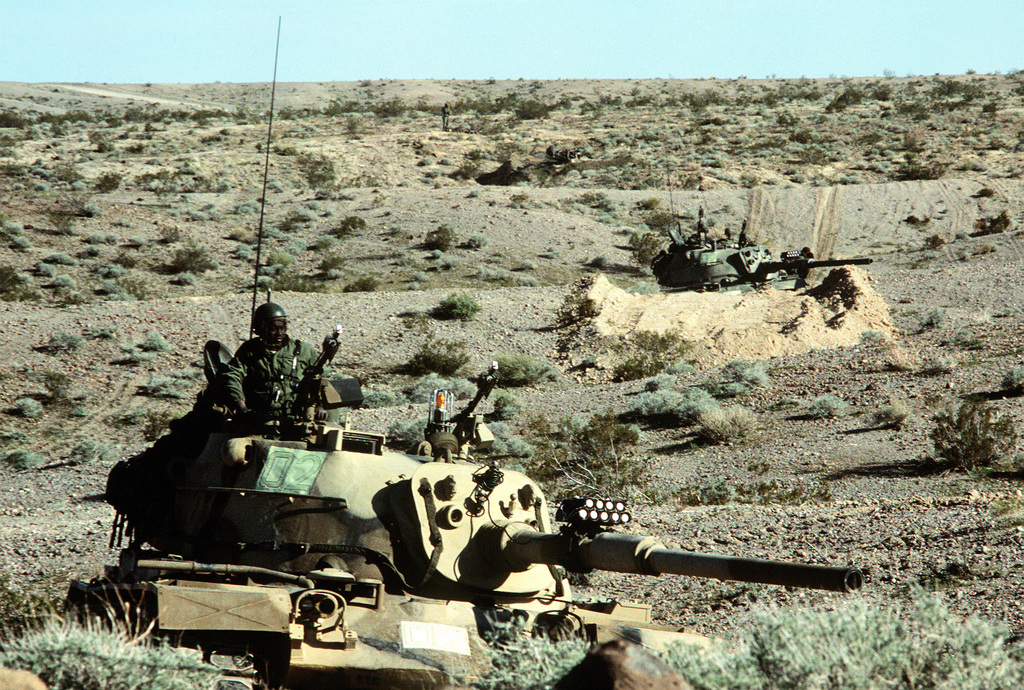 """Army M-60 tanks are prepared for a confrontation with """"enemy forces"""" during Exercise Gallant Eagle '82"""