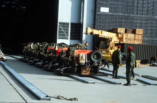 Cargo riggers from the 82nd Airborne Division prepare cargo for the Low Altitude Parachute Extraction System (LAPES) drops over Fort Irwin during exercise Gallant Eagle '82