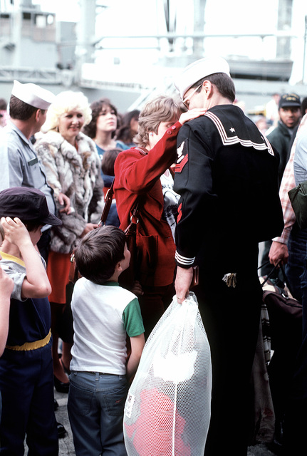 Crewmen from the nuclear-powered aircraft carrier USS ENTERPRISE (CVN-65) meet their families. The ENTERPRISE has returned to port from a short cruise after the completion of renovations that included the rebuilding of the superstructure
