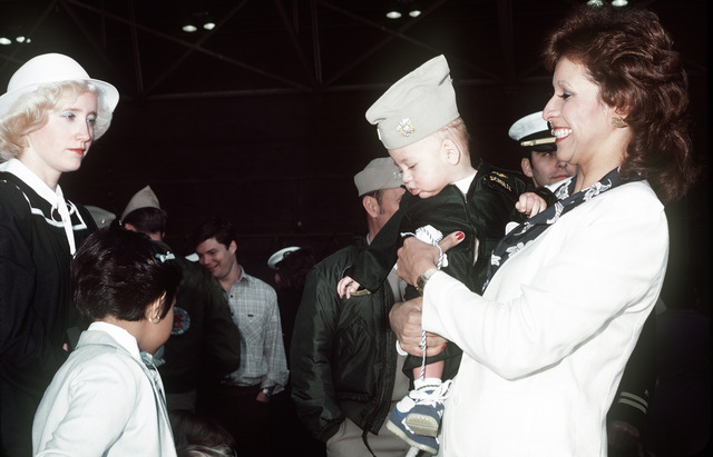 Families of crewmen from Light Attack Squadrons 27 and 97 (VA-27 and VA-97), aboard the USS CORAL SEA (CV-43), await their return from a Western Pacific deployment