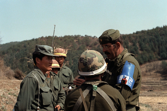 Major Gene Dudley (right), the official controller working with Orange and Blue Forces, tries to ease tensions after Orange Force officers are captured by troops of the 1ST Battalion, 35th Infantry, 25th Infantry Division, during the joint South Korean/US training Exercise TEAM SPIRIT '82