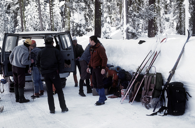 Members of Naval Air Station Lemoore, California, search and rescue team unload their equipment prior to the start of winter survival ski training