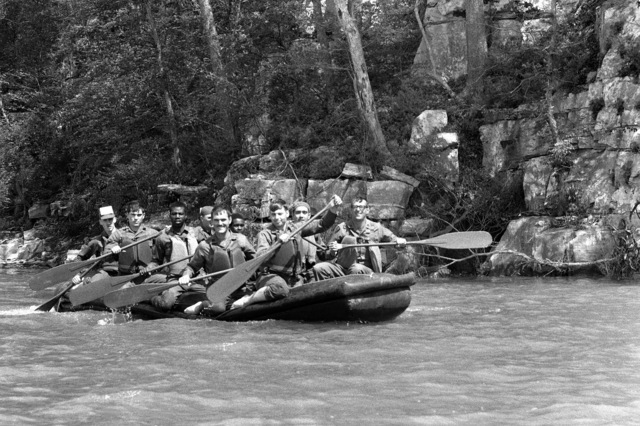 Members of the 101st Airborne Division (air assault) 2/31st Field Artillery, as they row down the river in a rubber raft during a water field training exercise
