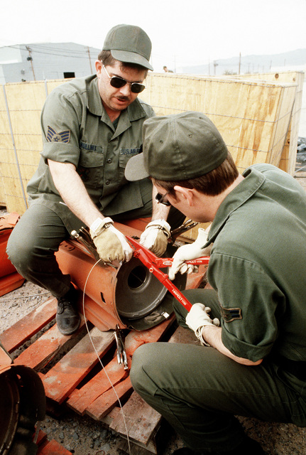 Personnel from the Fifth Munitions Maintenance Squadron remove the fuse wire on a 750-pound bomb during Exercise Gallant Eagle '82