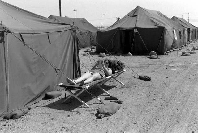 SRA Laurie Walborn relaxes on her cot in the tent city at the Marine Corps Logistics Base during Exercise Gallant Eagle '82