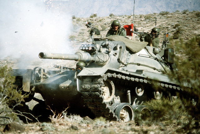 "The main gun of an Army M-48 tank is fired against the ""enemy"" during Exercise Gallant Eagle '82"