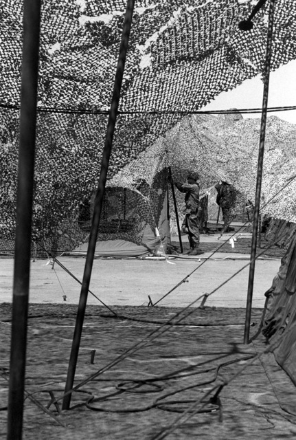 TSGT Ken Ruff checks a tent rigging in the Rapid Deployment Joint Task Force compound during Exercise Gallant Eagle '82