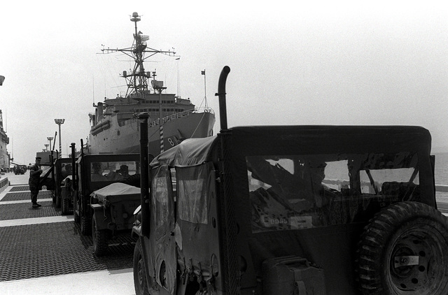 U.S. Marine jeeps are lined up waiting to be loaded aboard the amphibious transport dock USS DUBUQUE (LPD-8) during exercise Team Spirit '82