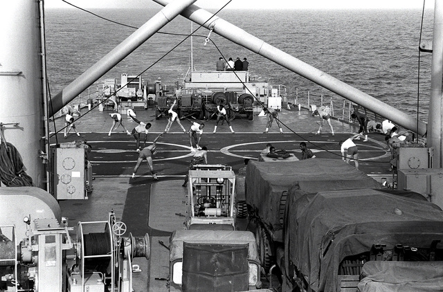 U.S. Marines exercise on the flight deck of the tank landing ship USS FRESNO (LST-1182) while en route to South Korea during exercise Team Spirit '82