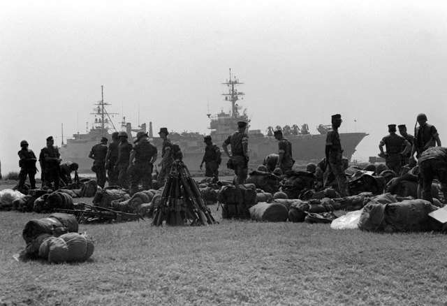 U.S. Marines prepare to board the amphibious assault ship USS TRIPOLI (LPH-10) for the trip to South Korea during exercise Team Spirit '82