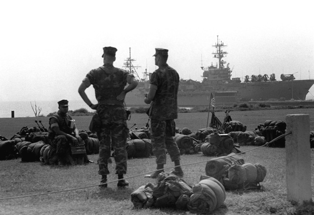 U.S. Marines wait with their sea bags to board the amphibious assault ship USS TRIPOLI (LPH-10) for the trip to South Korea during exercise Team Spirit '82