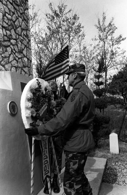 Major General Alexander M. Weyand, Commander, 25th Infantry Division, places a wreath on the Task Force Smith Memorial during a ceremony honoring the men who fell near this spot on July 5, 1950
