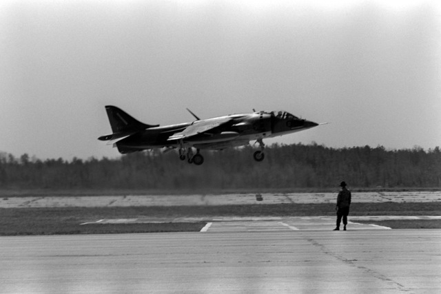 A Marine AV-8A Harrier aircraft lands at Blackstone Airfield to take part in the Combined Arms Operation (CAO 1-82). The Marines participating are a part of the 6th Marine Amphibious Brigade