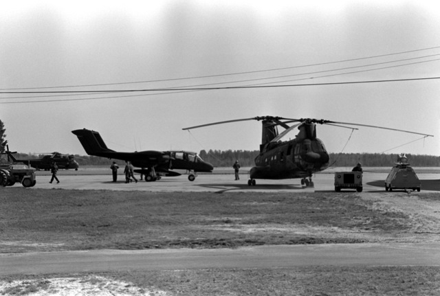 A Marine OV-10A Bronco aircraft and a CH-46 Sea Knight helicopter are being readied for participation in the Combined Arms Operation (CAO 1-82). The Marines participating are a part of the 6th Marine Amphibious Brigade