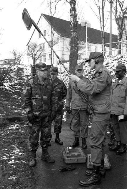 From left to right, SGM of the Army William A. Connelly, CSM Seals, Barker and Gore watch as SPC Delta explains the method of how to use a mine detector