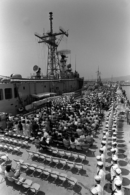 An overall view of the guided missile frigate USS LEWIS B. PULLER (FFG-23) and the crowd attending the commissioning ceremony for the ship