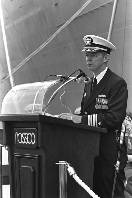 CAPT Martin Hill, supervisor of shipbuilding, speaks to the guests attending the commissioning ceremony for the destroyer tender USS CAPE COD (AD-43)