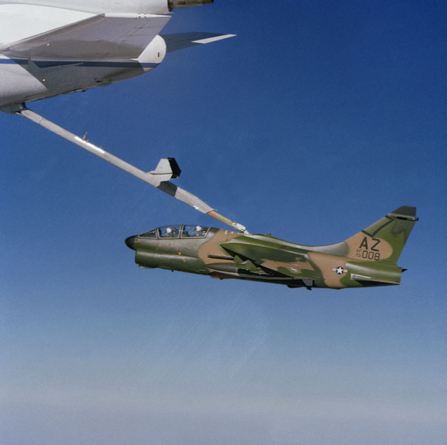A view of a KC-10A Extender aircraft (tail section) refueling an A-7K Corsair II aircraft in flight
