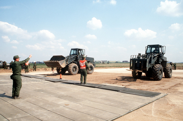 "A rapid runway repair team from the 601st Civil Engineering Squadron, covers a recently filled ""bomb crater"" with matting, during Exercise UREX '82"