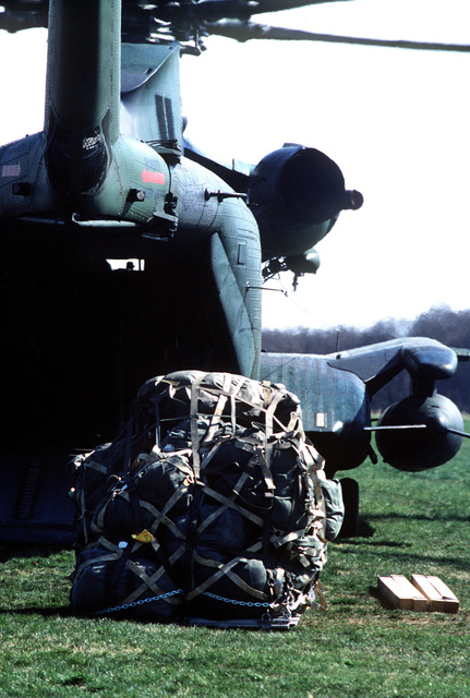 A rear view of a CH-53C Super Jolly helicopter from the 601st Tactical Air Support Squadron, as preparations are made to onload a pallet through it's cargo opening during Exercise UREX '82