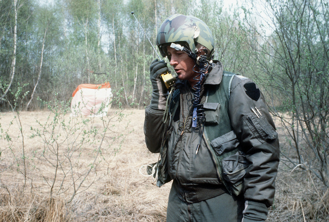 MAJ Ed Kroboth of the 704th Tactical Airlift Squadron establishes communications with a search and rescue helicopter, as he acts as a downed pilot during Exercise UREX '82
