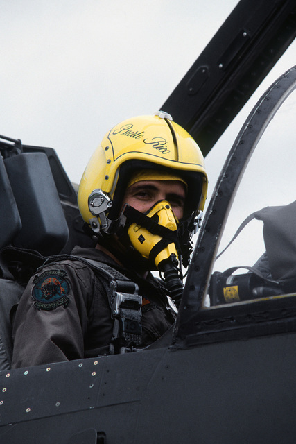 A pilot aboard an A-7 Corsair II aircraft prepares for flight during exercise Ocean Venture '82. The pilot is a member of the Puerto Rico Air National Guard