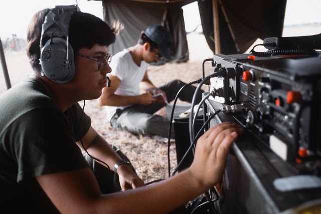 An airman operates radio equipment in a tent during exercise Ocean Venture '82. The airman is assigned to the 1901st Communication Group