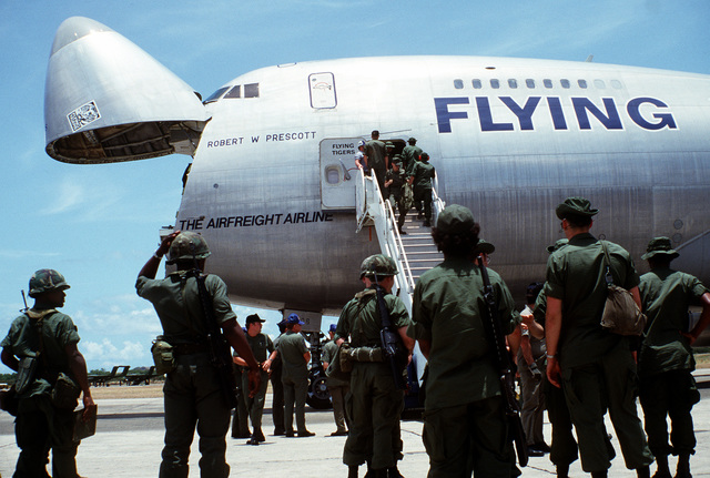 Members of the 372nd Transportation, 101st Airborne Division, disembark a 747 Flying Tiger aircraft during exercise Ocean Venture '82