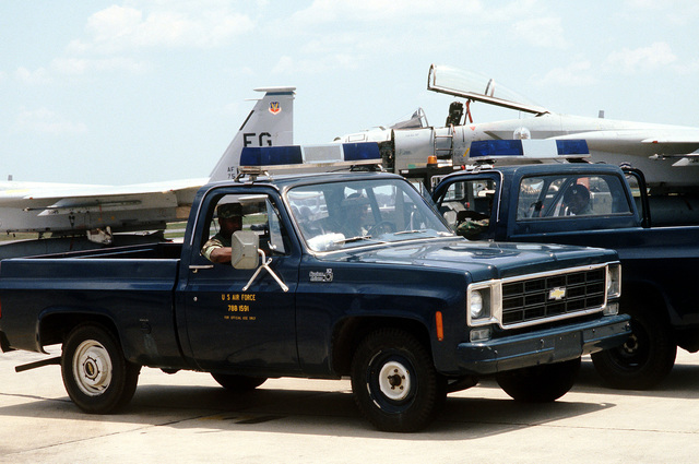 Security policemen patrol the flight line during exercise Ocean Venture '82