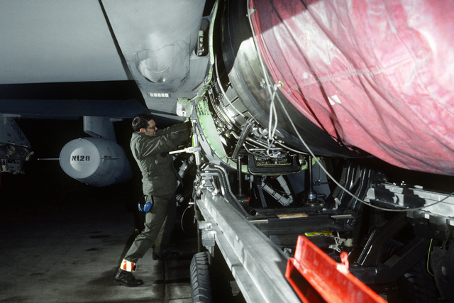 SSGT Richard an inspection of the Pratt and Whitney engine on an F-16 Fighting Falcon aircraft from the 429th Tactical Fighter Squadron, Nellis Air Force Base, Nevada, during exercise Coronet Wrangler