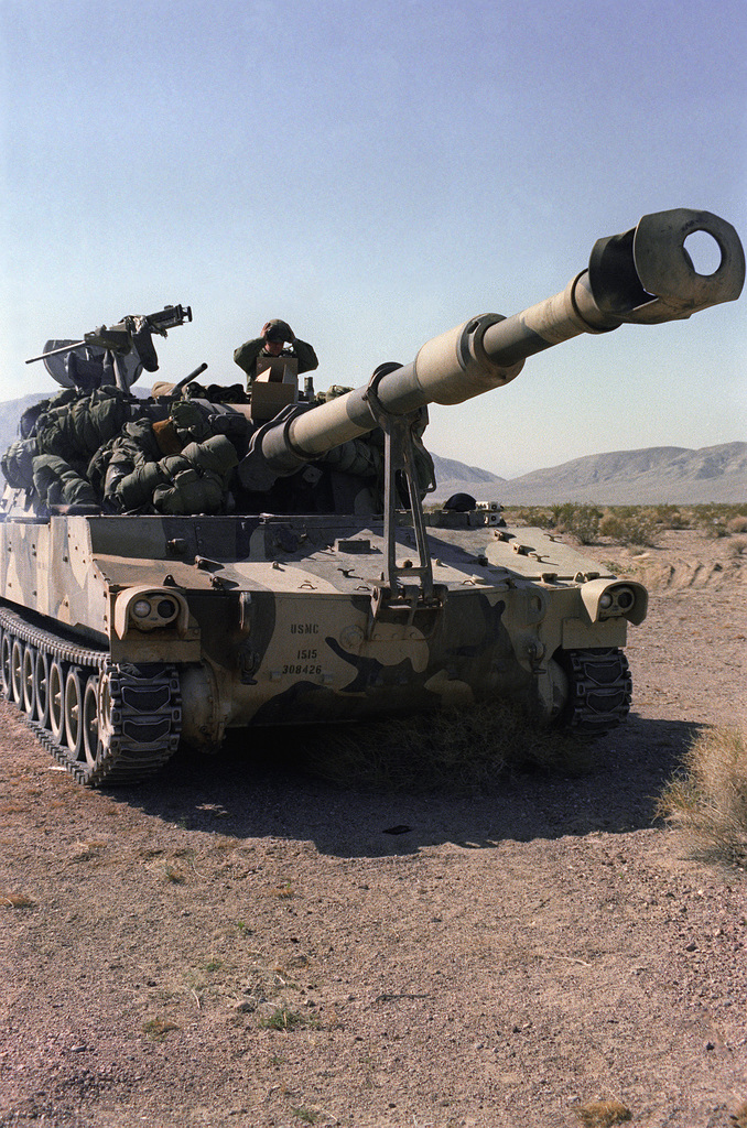 The crew of a Marine Corps M-109 self-propelled 155mm howitzer prepares to move to a new location during Exercise Gallant Eagle '82