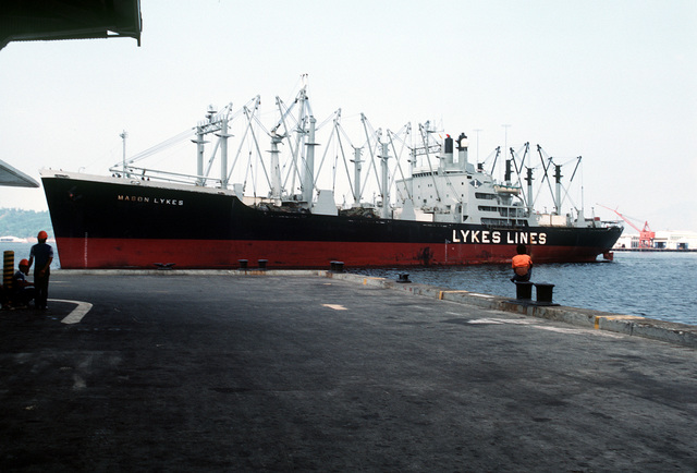 A port bow view of the Military Sealift Command merchant ship USNS MASON LYKES as it approaches the dock at the Naval Supply Depot. The ship is carrying 59 Vietnamese refugees who were rescued from a small boat in the open ocean